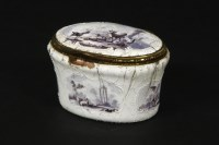 Lot 57 - An 18th century  enamelled oval box