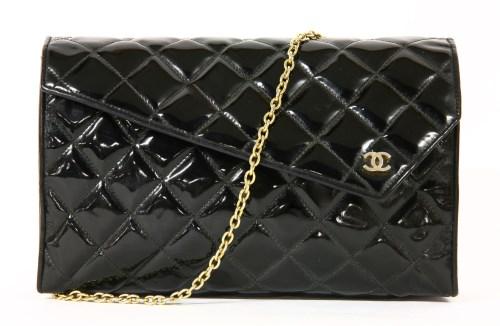 Lot 1004-A vintage Chanel black patent quilted clutch handbag