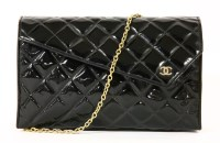 Lot 1004-A vintage Chanel black patent quilted clutch handbag