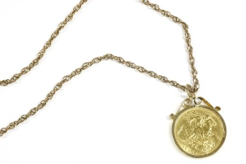 Lot 11-A 1904 sovereign in a 9ct gold mount on a Prince of Wales chain