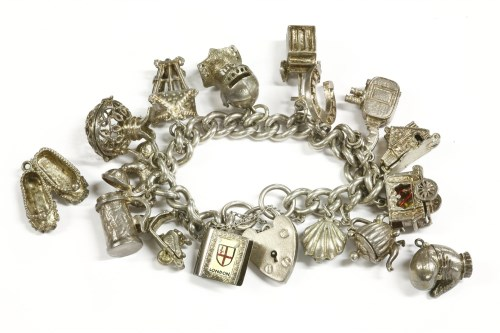 Lot 8-A silver charm bracelet with padlock