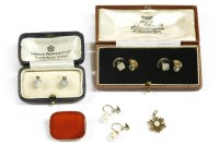 Lot 43 - A pair of cased white gold mother of pearl and seed pearl dress studs