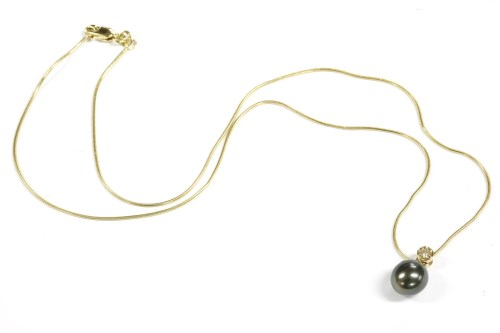 Lot 12-A single cultured freshwater and diamond pearl pendant