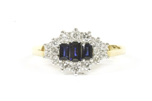 Lot 2-An 18ct gold sapphire and diamond cluster ring
