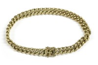 Lot 28 - A Continental yellow metal hollow curb link bracelet