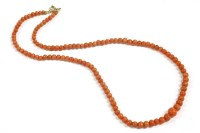Lot 40 - A single row graduated coral bead necklace