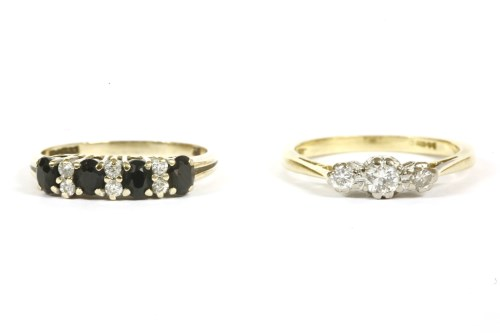 Lot 20-An 18ct gold three stone diamond ring