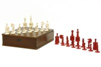 Lot 78 - A 19th century bone red and natural coloured chess set