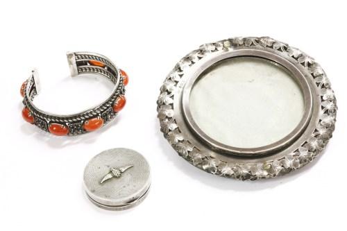 Lot 45-A silver cuff bangle set with Cornelian cabochons
