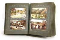 Lot 86 - A quantity of postcards in an album