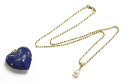 Lot 31-A gold single diamond and cultured pearl drop pendant