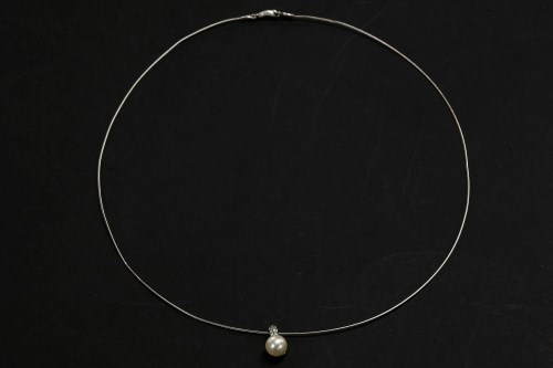 Lot 49-A white gold single stone cultured pearl pendant