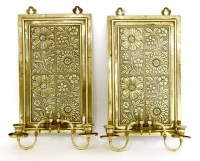 Lot 54 - A pair of brass wall sconces
