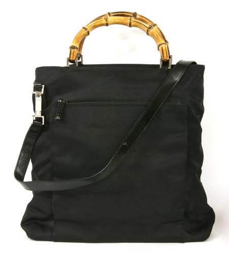 Lot 1014-A Gucci black canvas cross-body handbag
