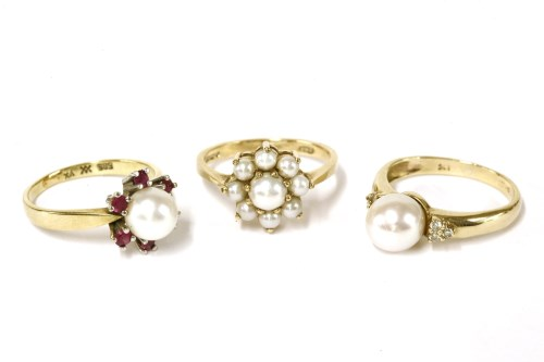 Lot 17-A 9ct gold single stone cultured pearl and diamond trefoil shoulder ring