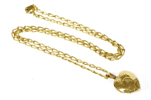 Lot 2-A single stone 9ct heart shaped locket on a gold plated chain