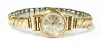 Lot 13-A ladies gold Tressa mechanical watch