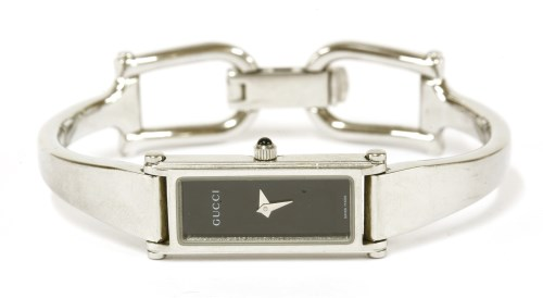 Lot 3-A ladies stainless steel Gucci 1500L quartz bangle watch