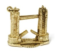 Lot 25-A 9ct gold charm in the form of tower bridge
