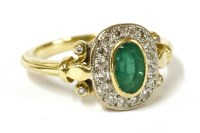 Lot 12-An 18ct gold emerald and diamond cluster ring