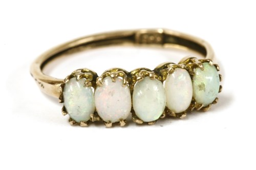 Lot 10-A gold five stone opal cabochon ring
