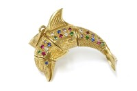 Lot 27-A 9ct gold articulated dolphin pendant