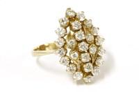 Lot 20 - A gold diamond simulant lozenge shaped cluster ring