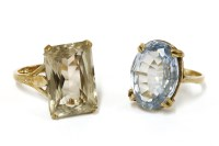 Lot 31-A gold single stone scissor cut smokey quartz ring