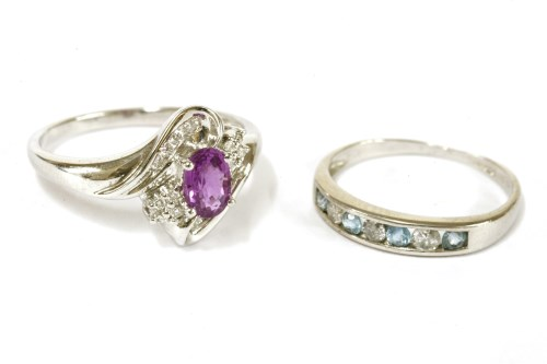 Lot 16-A white gold purplish/pink sapphire and diamond crossover cluster ring