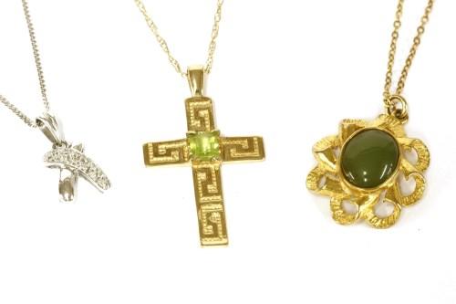 Lot 53-A white gold diamond set cross over pendant on chain