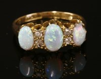 Lot 13-An 18ct gold Edwardian opal and diamond ring