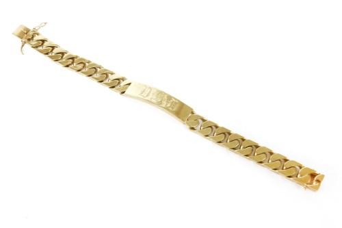 Lot 51-A 9ct gold identity bracelet