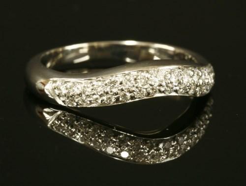 Lot 61-A platinum diamond set Bulgari 'Corona' curved band ring