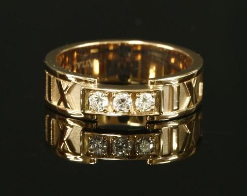 Lot 58-A ladies' 18ct rose gold diamond set Tiffany 'Atlas' band ring