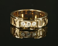 Lot 58-A ladies' 18ct rose gold diamond set Tiffany 'Atlas' band ring