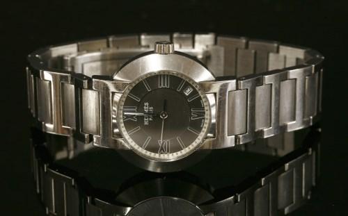 Lot 15-A ladies' stainless steel Hermès Nomade Quartz bracelet watch