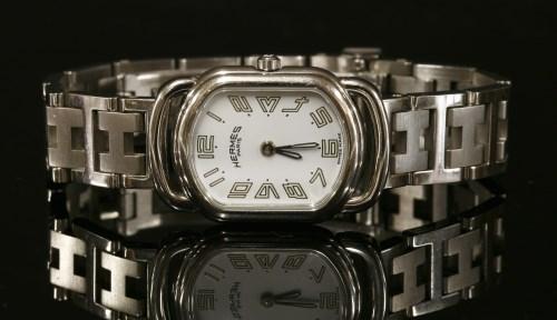 Lot 12-A ladies' stainless steel Hermès Rallye Quartz bracelet watch