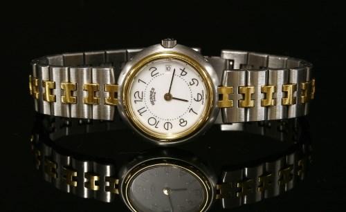 Lot 56-A ladies' bi-colour Hermès Profile Quartz bracelet watch