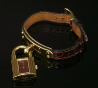 Lot 8-A ladies' gold plated Hermès quartz Kelly strap watch