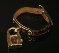 Lot 8 - A ladies' gold plated Hermès quartz Kelly strap watch