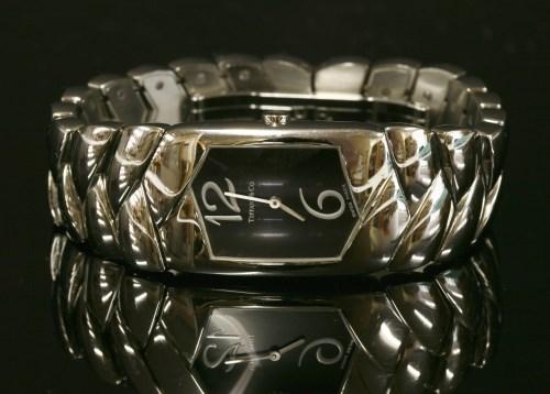 Lot 17-A ladies' stainless steel Tiffany Tesoro quartz bracelet watch