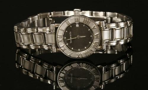 Lot 19-A ladies' stainless steel Tiffany & Co. Atlas Quartz bracelet watch