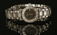 Lot 19-A ladies' stainless steel Tiffany & Co. Atlas Quartz bracelet watch