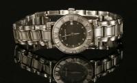 Lot 19 - A ladies' stainless steel Tiffany & Co. Atlas Quartz bracelet watch