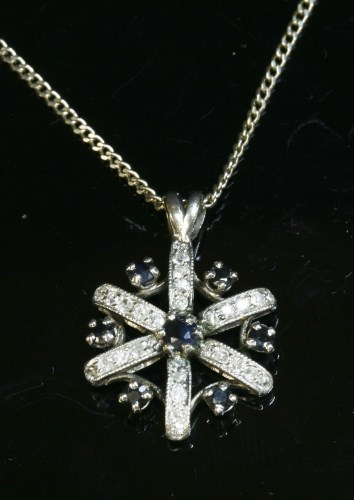Lot 9-A sapphire and diamond cluster pendant