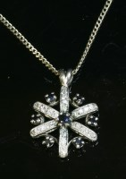 Lot 9 - A sapphire and diamond cluster pendant