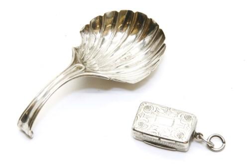 Lot 70-A Georgian silver shell caddy spoon