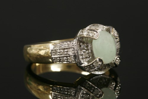 Lot 3-A 9ct gold jade cabochon and diamond cluster ring