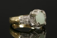 Lot 3 - A 9ct gold jade cabochon and diamond cluster ring