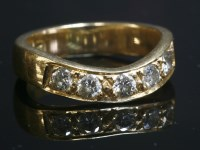Lot 7-A gold diamond set wave half eternity ring